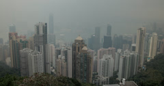 4K video of a smoggy Hong Kong island and harbour from Victoria Peak Stock Footage