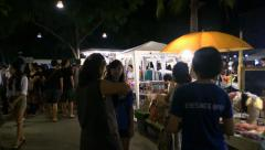 Move between people on the Asian night market, Thailand. Flycam. Stock Footage