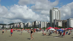 Tourists enjoying a sunny day at Santos Beach, Sao Paulo, Brazil. 22 Stock Footage