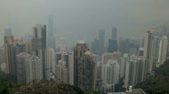 HD video of a smoggy Hong Kong island and harbour from Victoria Peak Stock Footage