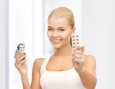 young woman with pills - stock photo