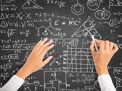 Science and math formulas on chalkboard Stock Photos