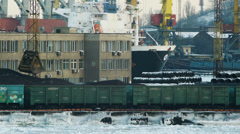 Port cranes unloads boxcars with coal - stock footage
