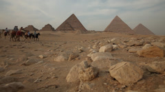 Pyramids of Giza, camels and horses Stock Footage