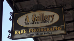 Photo Gallery sign at New Orleans French Quarter Stock Footage