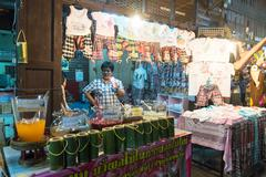 unknown seller who sells souvenirs, a traditional thai at amphawa floating ma - stock photo