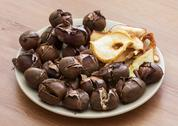 Stock Photo of tasty roasted chestnuts and dried sliced apples