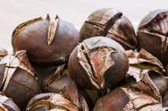 Stock Photo of pile of roasted chestnuts