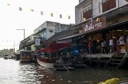 Stock Photo of samutsongkhram, thailand- january 4, 2014: tourists visiting the amphawa floa