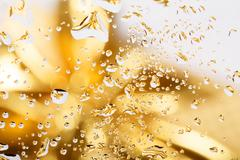 golden abstract background with water drops - stock photo
