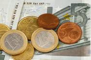 Stock Photo of macro photography of euro money and coins