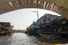 samutsongkhram, thailand- january 4, 2014: tourists visiting the amphawa floa - stock photo