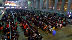 Unidentified people gather in Chengdu railway station Stock Footage