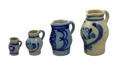 4 Handpainted Handmade Ceramic Jugs On White - stock photo