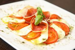 Mozarella and tomatos Stock Photos