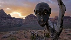 African Mask Primitive in Wilderness with Pan Stock Footage
