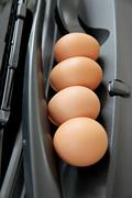 eggs are placed in front of car. - stock photo
