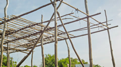 framework for a wooden house on piles. cambodian village - stock footage
