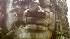 stone face on the tower of the ancient temple. bayon, angkor, cambodia - stock footage