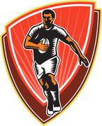 Rugby player running ball front woodcut Stock Illustration