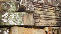 Stone blocks from the ancient wall of the temple. angkor, cambodia Stock Footage