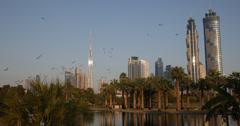 Ultra HD 4K Safa Park Dubai Skyline Skyscraper Famous City Burj Khalifa Bird Fly Stock Footage
