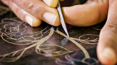 Patterning the surface of the varnish in the workshop. burma, mandalay Stock Footage