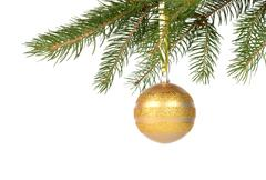Stock Photo of Christmas tree with golden bauble isolated on white