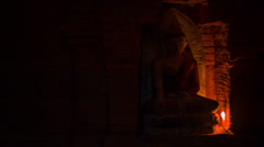 Buddha candlelit statue at the ancient temple Stock Footage