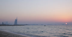 Ultra HD 4K Horizon Sunset Dubai Burj Al Arab Beachfront Jumeirah Exotic Beach Stock Footage