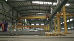 Wide shot of factory with metal beams Stock Footage