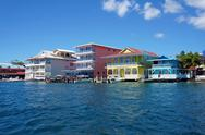 Stock Photo of colorful caribbean buildings over the water