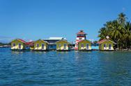 Stock Photo of tropical vacation bungalows over water