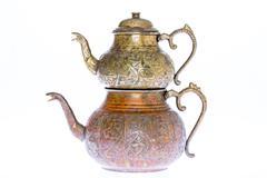 antique style engraved copper turkish teapot - stock photo