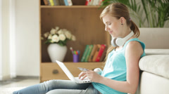 Stock Video Footage of Charming girl sitting on carpet using laptop holding credit card