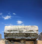 fragment of ancient ruins with lettering - stock photo