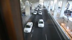 Passengers near the airport through the glass with reflection Stock Footage