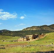 landscape with ancient amphitheater in turkey - stock photo