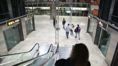 Girl down the escalator in the airport Barajas. Stock Footage