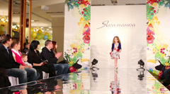 Girl on the runway at a fashion show in a children mall Stock Footage