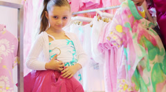 Mother helping her daughter to choose clothes in store Stock Footage