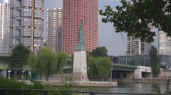 Liberty Statue river seine honor monument famous Paris France french capital day Stock Footage