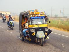 Stock Photo of auto rickshaw on indian road