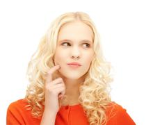 girl thinking with finger on her cheek - stock photo