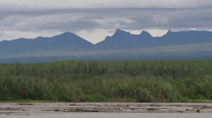 Dark Forbidding Jagged Peaks in the Distance - Alaska Scenic Copper River Stock Footage