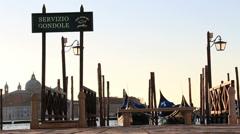 Female tourist walks past Servizio Gondole, Venice Stock Footage