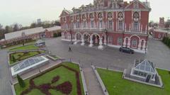 People walk near edifice of Petrovsky Travelling Palace Stock Footage