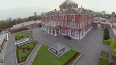 Black car stands near edifice of Petrovsky Travelling Palace Stock Footage