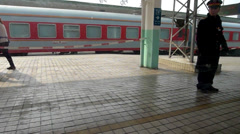 Moving train leaves Baoji railway station. Stock Footage