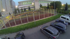 Cars ride by parking near sports complex of MGTU Stock Footage
